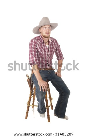 bootless young cowboy sitting on stool waiting to get new boots