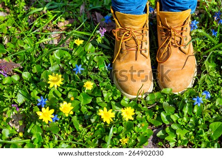 boots on a background of a blossoming meadow  - stock photo