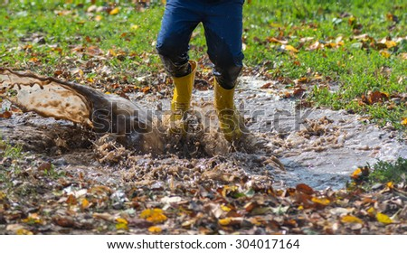 Boots splashing in a puddle
