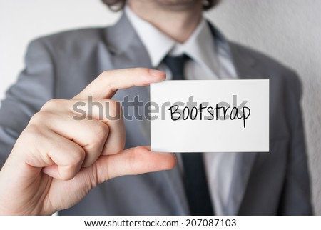 Bootstrap. Businessman in suit with a black tie showing or holding business card