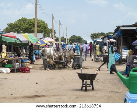 BOR, SOUTH SUDAN-OCTOBER 30 2013: Unidentified people shop in the open air market in Bor, South Sudan - stock photo