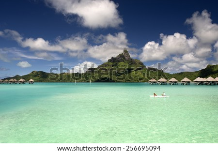 Bora Bora and South Pacific ocean, over water bungalows, French Polynesia - stock photo