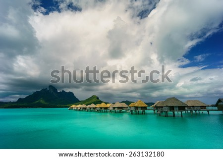 Bora Bora under dramatic clouds - stock photo