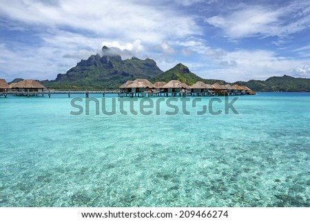 Bora Bora with overwater Bungalows. - stock photo