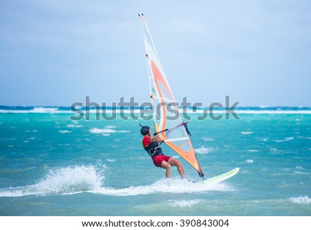 Boracay island, Philippines - February 08: windsurfer enjoying wind power on Bulabog beach on February 08, 2016, Boracay island, Philippines. - stock photo