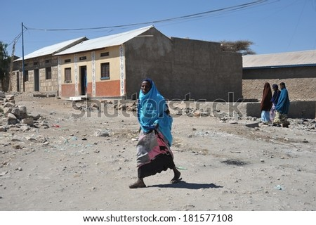 BORAMA, SOMALIA - JANUARY 13, 2010: Somalis in the street of the city of Borama in North-West Somalia. Located near the border with Ethiopia. Much of the population lives in poverty.