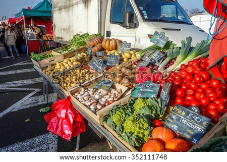 Bordeaux, France, December 06, 2015: Sunday public market, producers, farmers bring their goods to sell on the market. Some fresh vegetables.