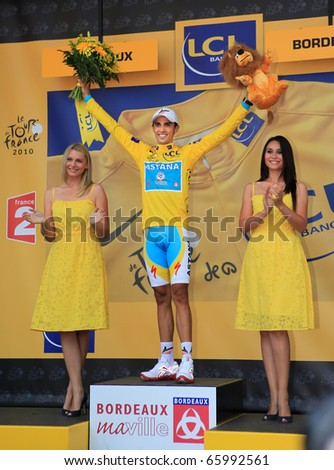 BORDEAUX, FRANCE - JULY 23: Cyclist Alberto Contador wears the yellow jersey and stands on the podium after the 18th stage of Tour de France 2010 on July 23, 2010 Tour de France in Bordeaux, France.