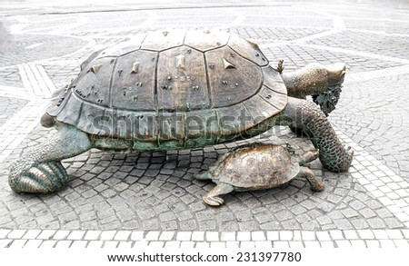BORDEAUX, FRANCE - JULY 31: Turtles with grapes sculpture in the Place de la Victoire, France, on July 31, 2014.