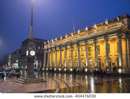 Bordeaux, France - March 25, 2016. People walking in front of Grand Theatre de Bordeaux at night. The theatre is home to the Opera National de Bordeaux and the Ballet National de Bordeaux. Bordeaux. - stock photo