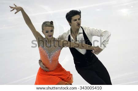 BORDEAUX, FRANCE - NOVEMBER 13, 2015: Alexandra STEPANOVA / Ivan BUKIN of Russia perform short dance during the official training at Trophee Bompard ISU Grand Prix at Patinoire Meriadeck Arena. - stock photo