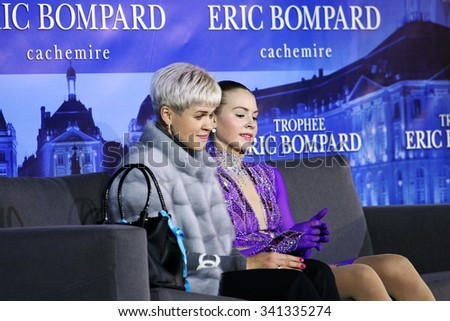 BORDEAUX, FRANCE - NOVEMBER 13, 2015 : Angelina KUCHVALSKA (R) of Latvia and her coach J. Platonova wait for marks after short program at Trophee Bompard ISU Grand Prix at Patinoire Meriadeck Arena.