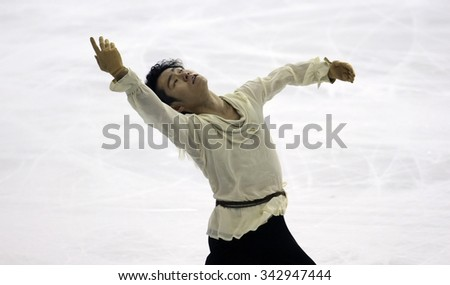BORDEAUX, FRANCE - NOVEMBER 13, 2015: Daisuke MURAKAMI of Japan performs short program during the official training at Trophee Bompard ISU Grand Prix at Patinoire Meriadeck Arena. - stock photo