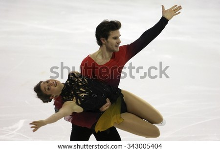 BORDEAUX, FRANCE - NOVEMBER 13, 2015: Laurence FOURNIER BEAUDRY / Nikolaj SORENSEN of Denmark perform short dance during the official training at Trophee Bompard ISU Grand Prix at Meriadeck Arena. - stock photo