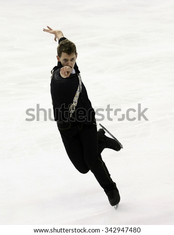 BORDEAUX, FRANCE - NOVEMBER 13, 2015: Maxim KOVTUN of Russia performs short program during the official training at Trophee Bompard ISU Grand Prix at Patinoire Meriadeck Arena. - stock photo