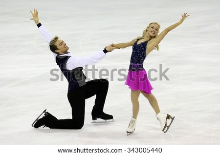 BORDEAUX, FRANCE - NOVEMBER 13, 2015: Penny COOMES / Nicholas BUCKLAND of Great Britain perform short dance during the official training at Trophee Bompard ISU Grand Prix at Patinoire Meriadeck Arena. - stock photo