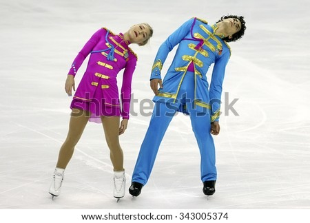 BORDEAUX, FRANCE - NOVEMBER 13, 2015: Piper GILLES / Paul POIRIER of Canada perform short dance during the official training at Trophee Bompard ISU Grand Prix at Patinoire Meriadeck Arena. - stock photo