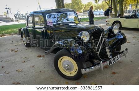 BORDEAUX, FRANCE, November 01, 2015 : Vintage CITROEN TRACTION 11 black, this vintage car is the French charm - Public exhibition collection of vintage antique classic cars.