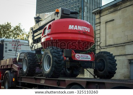 BORDEAUX, FRANCE - October 6, 2015 : Telescopic electric access platform providing vertical safe lifting capability. Transported on a long truck - stock photo