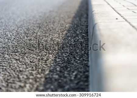 Border among sidewalk and the road - stock photo