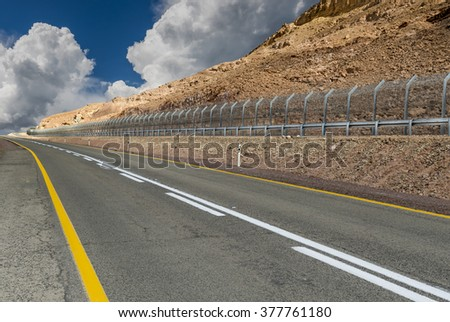 Border between Egypt and Israel in desert of the Negev  - stock photo