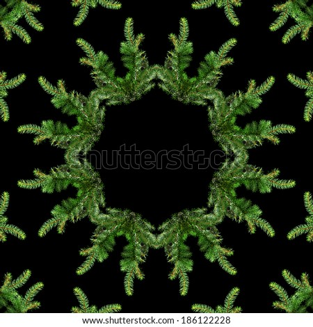 Border frame of fir branch with copy space isolated on black background - stock photo