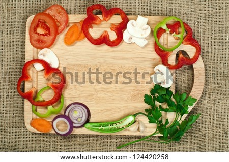 Border from vegetables on kitchen board - stock photo