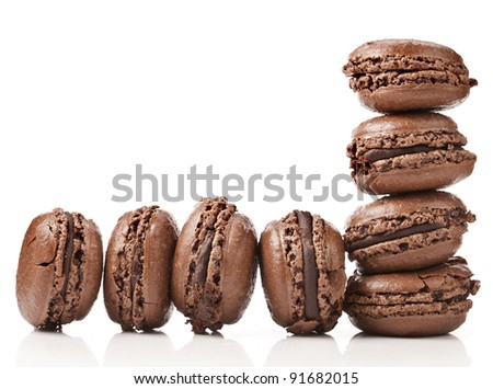 border of chocolate macaroons  isolation of a white background - stock photo