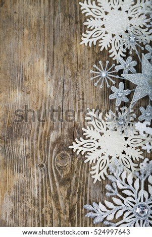 Border of Christmas snowflakes on old wooden background