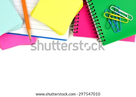 Border of colorful notebooks and school supplies on a white background  - stock photo