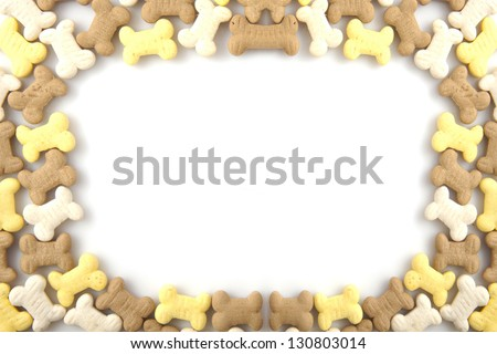Border of dog cookies for background use - stock photo