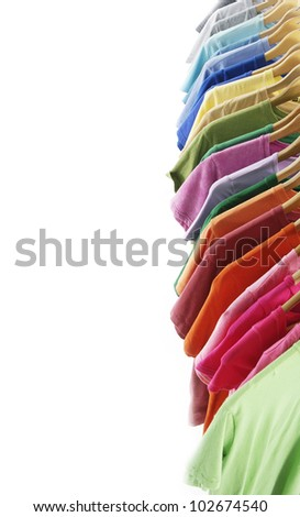 Border of fashion clothing on hangers at the show - stock photo