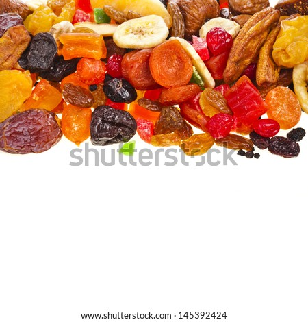 Border of mix dried fruits on white background - stock photo