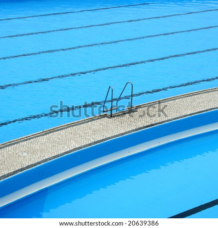 border of pool and stair, with blue calm water - stock photo