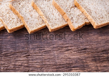 border of slice whole wheat bread on wooden table top