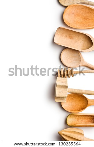 border of wooden kitchen utensils  on white background - stock photo