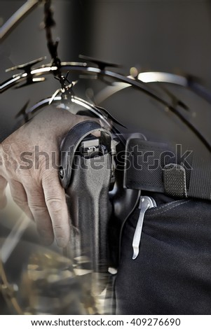 border patrol police man with gun concept power and unyielding force photograph - stock photo