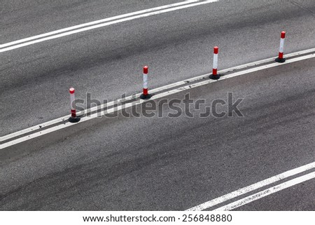 Border pole at the middle of the road/Road Edge Pole - stock photo