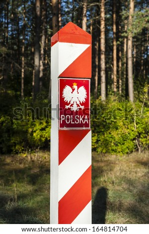 Border post on the frontier with the emblem of the Polish.  - stock photo