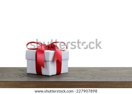 border with white gift box with red ribbon bow, holiday template - stock photo