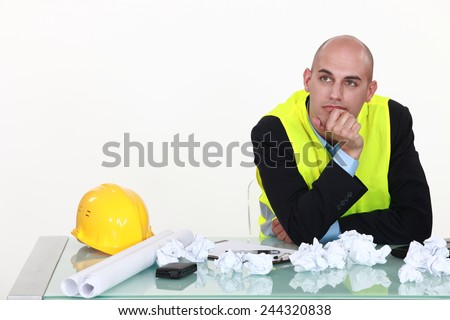 Bored architect daydreaming - stock photo