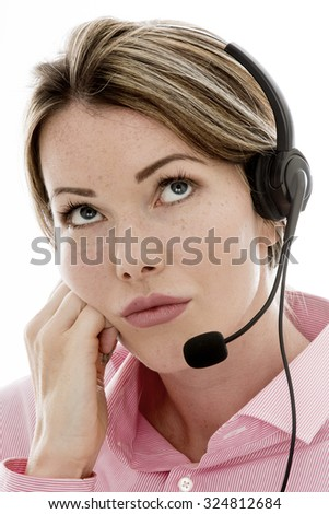 Bored Attractive Young Business Woman Using a Telephone Headset Making Sales Calls or Marketing Against a Plain White Background