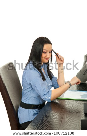 Bored business woman checking time at meeting - stock photo