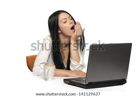 Bored business woman working on laptop looking very boring at the computer, Isolated white background