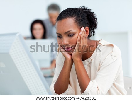 Bored businesswoman at her desk in the office - stock photo