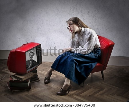 Bored by tv - stock photo