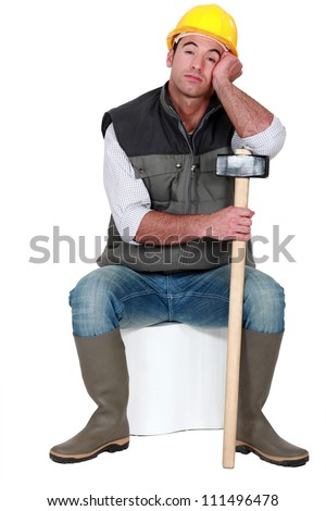 Bored construction worker - stock photo