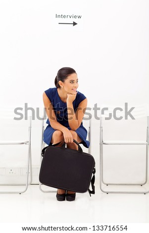 bored female applicant waiting for employment interview - stock photo