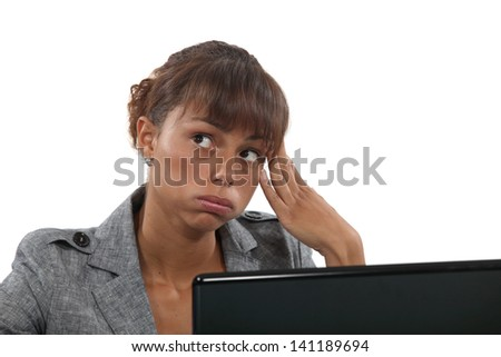 Bored female office worker - stock photo