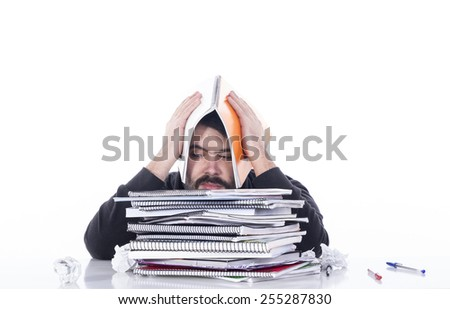 Bored guy with homeworks - stock photo